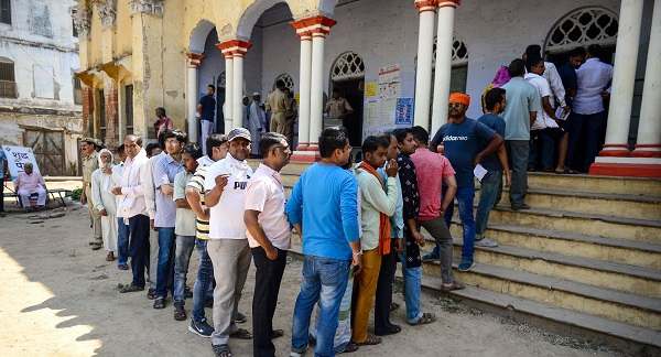 Indian voters queue at a polling station to cast their vote in Varanasi in Uttar Pradesh state on May 19, 2019, during the 7th and final phase of India's general election (Photo: SANJAY KANOJIA/AFP/Getty Images).