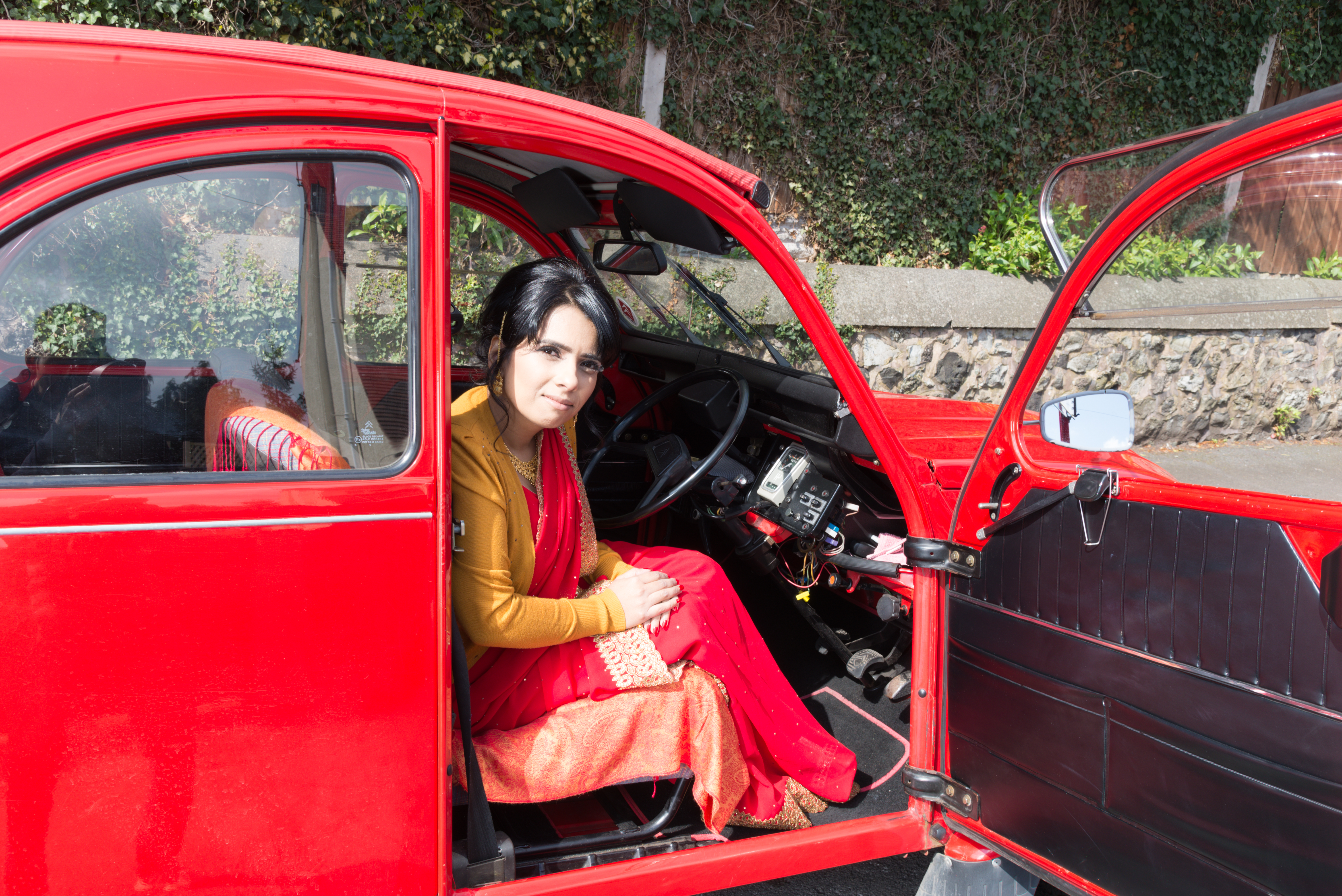Artist Dawinder Bansal (pictured) has collected stories and photographs of Asian women with their cars (Photo credit: Outroslide)
