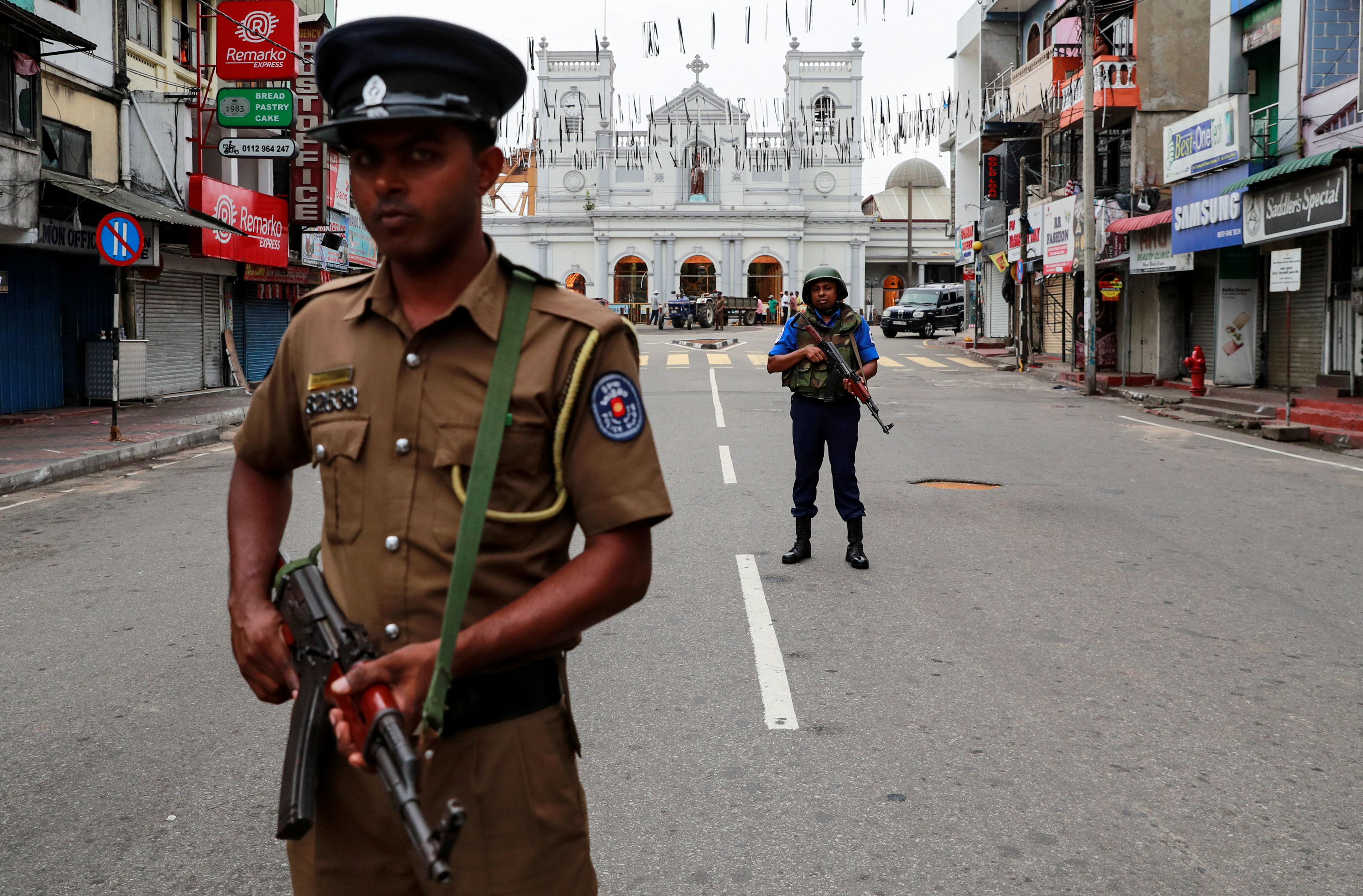 Security personnel stand guard in front of St Anthony's Shrine, days after a string of suicide bomb attacks across the island on Easter Sunday, in Colombo, Sri Lanka