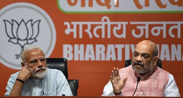 Indian prime minister Narendra Modi (L) and Bharatiya Janata Party president Amit Shah take part in a press conference in New Delhi on May 17, 2019 (Photo: MONEY SHARMA/AFP/Getty Images).