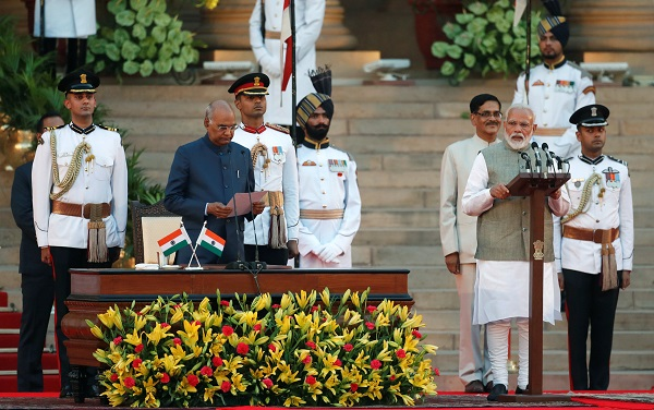 Indian president Ram Nath Kovind administers oath of India's prime minister Narendra Modi during a swearing-in ceremony at the presidential palace in New Delhi, India May 30, 2019 (Photo: REUTERS/Adnan Abidi).