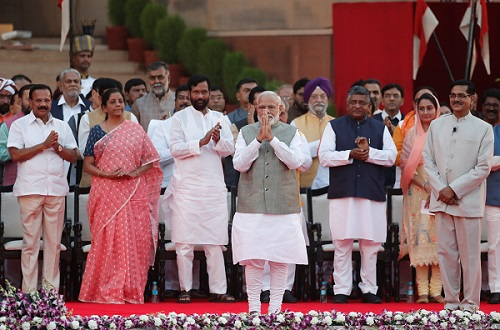India's prime minister Narendra Modi gestures towards supporters after his oath during a swearing-in ceremony at the presidential palace in New Delhi, India May 30, 2019 (Photo: REUTERS/Adnan Abidi).