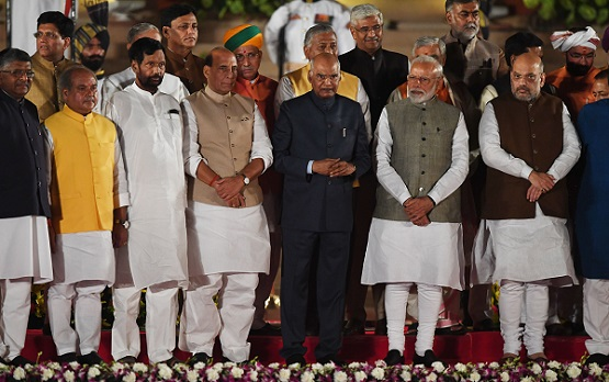 Newly sworn-in Indian prime minister Narendra Modi (2R) and cabinet ministers stand with president of India Ram Nath Kovind (C) after taking the oath of office at the president house in New Delhi on May 30, 2019 (Photo: PRAKASH SINGH/AFP/Getty Images).