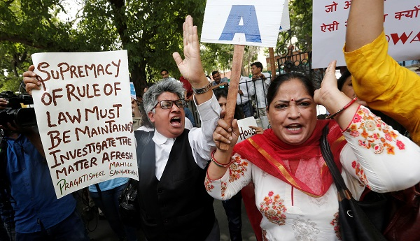 Demonstrators shout slogans during a protest after a panel of judges dismissed a sexual harassment complaint against Chief Justice of India (CJI) Ranjan Gogoi, outside Supreme Court in New Delhi, India May 7, 2019 (Photo: REUTERS/Adnan Abidi).