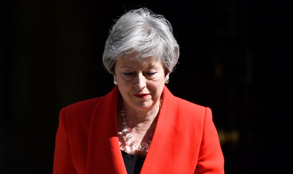 "On her first day as prime minister, May addressed the nation on the steps of her Downing Street office, pledging to fight the ""burning injustices"" that hold people back (Photo: Leon Neal/Getty Images)."