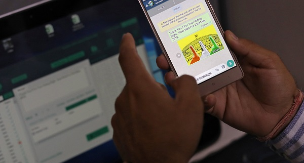 Rohitash Repswal, a digital marketer, checks a WhatsApp message that he sent using a software tool that appears to automate the process of sending messages to WhatsApp users, inside his office in New Delhi, India, May 8, 2019 (Photo: REUTERS/Anushree Fadnavis).