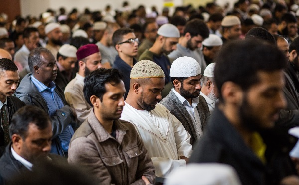 Men attend the first Friday prayers of Ramadan at the East London Mosque.