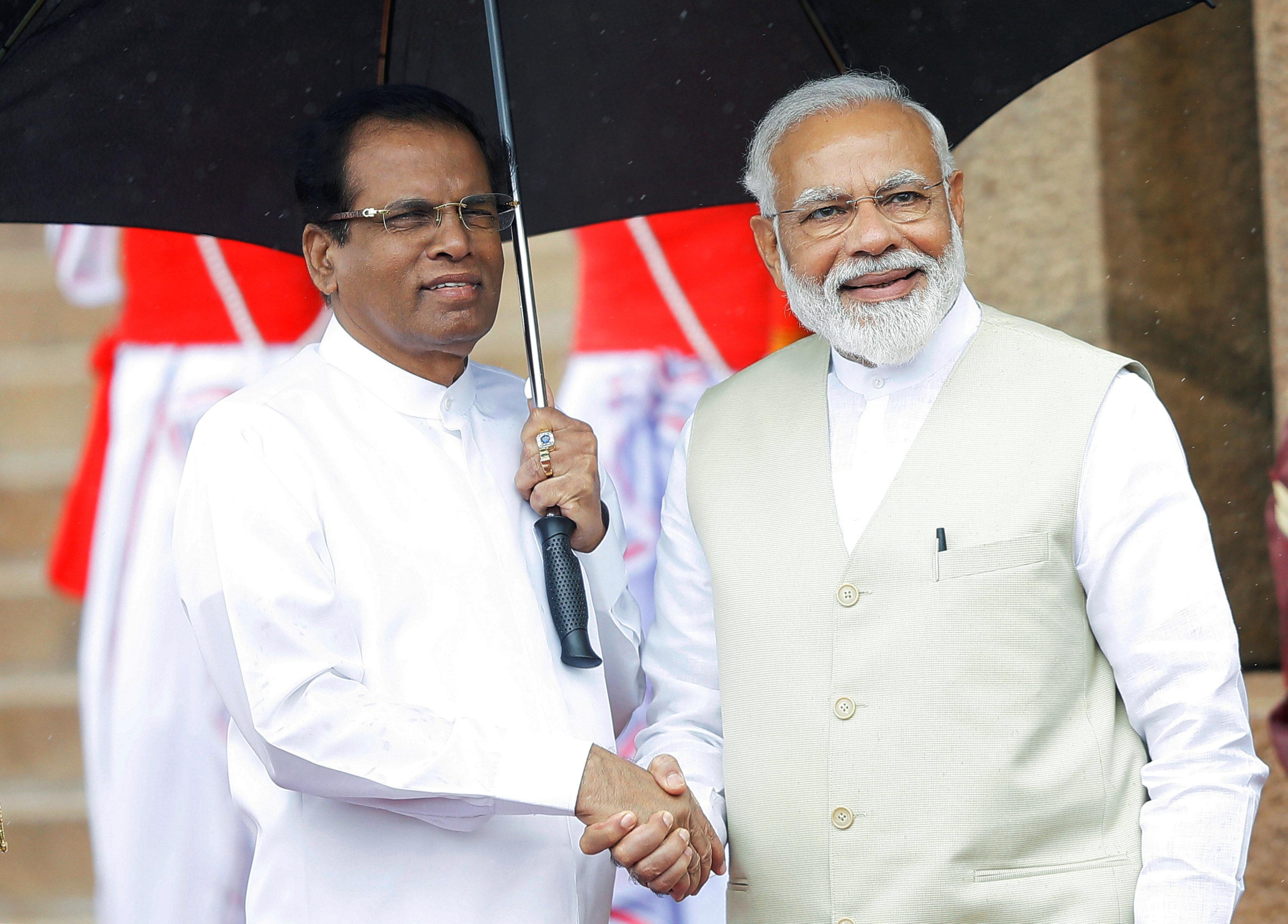 India's Prime Minister Narendra Modi shakes hands with Sri Lanka's President Maithripala Sirisena during his welcome ceremony at the Presidential Secretariat in Colombo, Sri Lanka, June 9, 2019. REUTERS/ Dinuka Liyanawatte