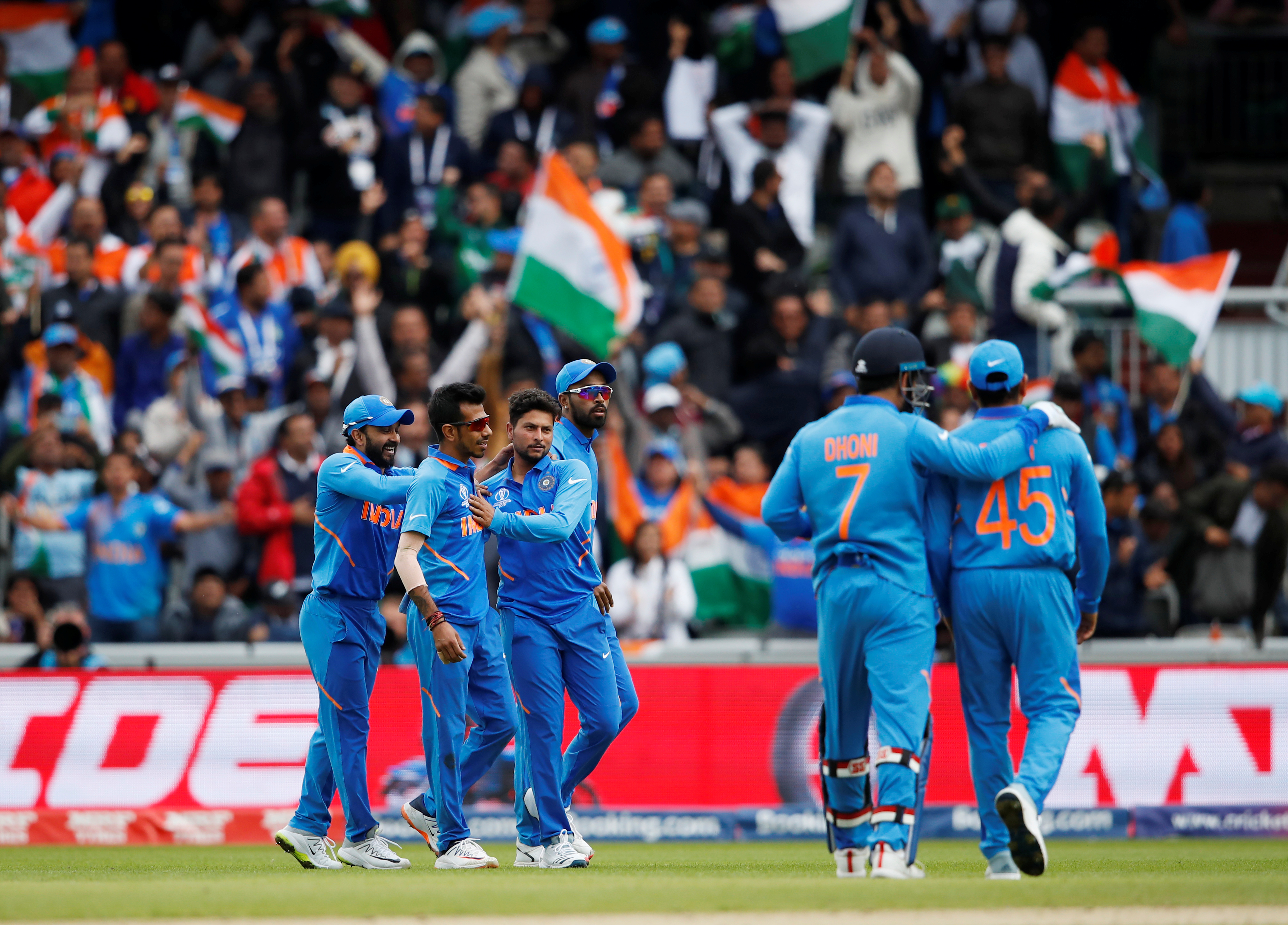 India's Kuldeep Yadav celebrates the wicket of Pakistan's Babar Azam with team mates.    (Action Images via Reuters/Andrew Boyers)