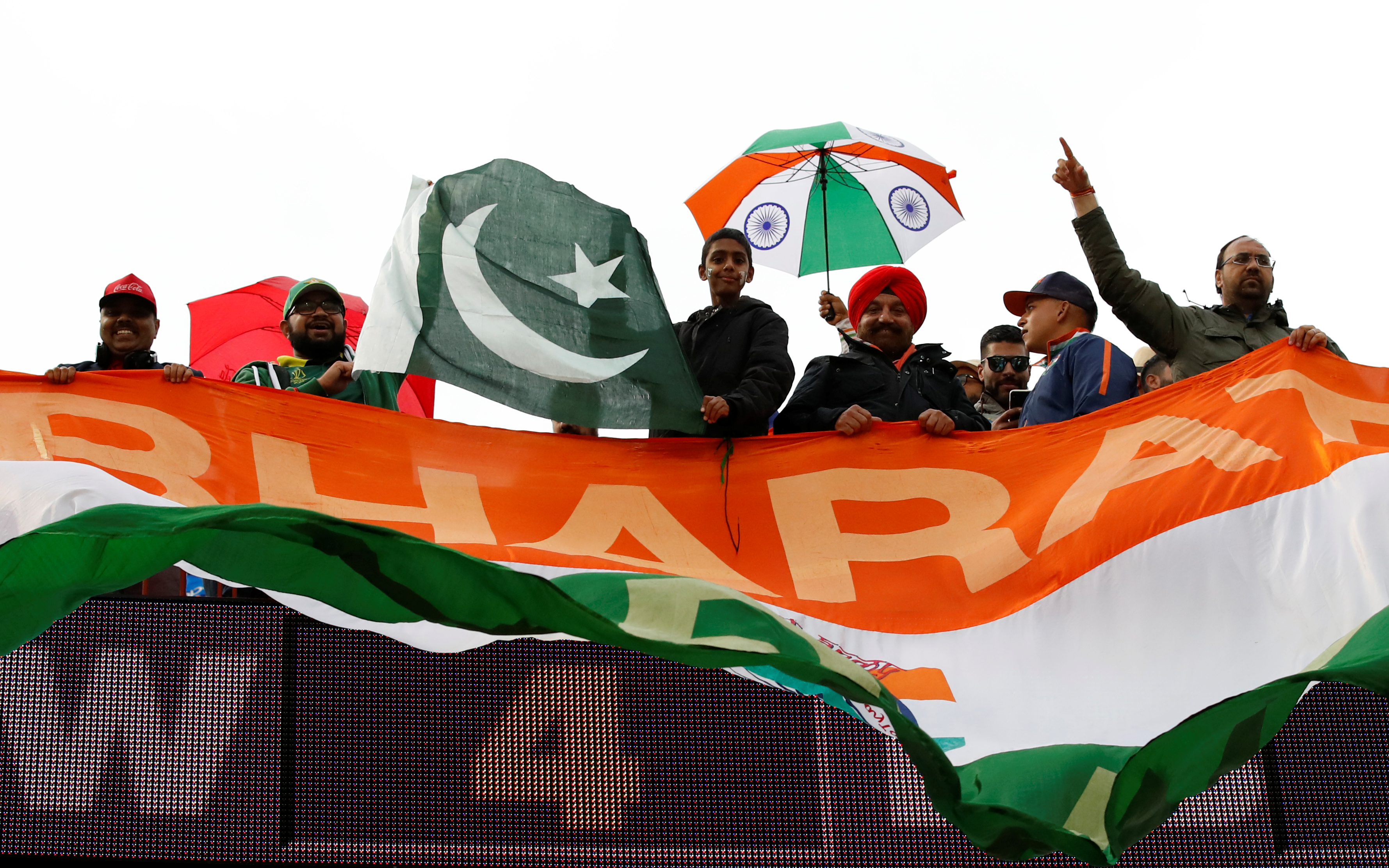 Cricket - ICC Cricket World Cup - India v Pakistan - Emirates Old Trafford, Manchester, Britain - June 16, 2019   General view of fans as rain stops play     Action Images via Reuters/Andrew Boyers