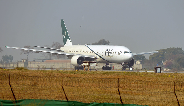 FILE PHOTO: A Pakistan International Airline (PIA) plane taxis on the runway. (Photo: FAROOQ NAEEM/AFP/Getty Images)