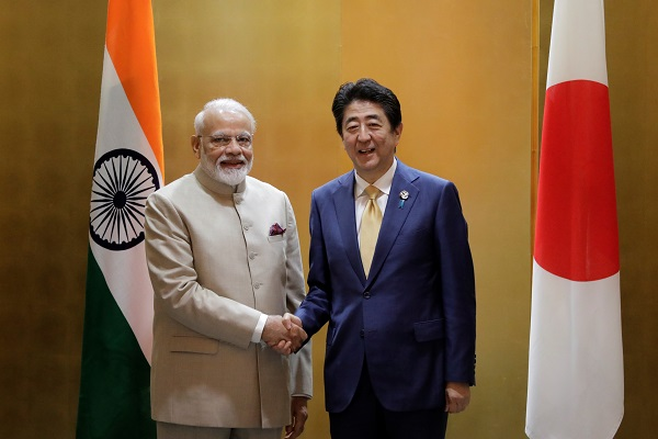Narendra Modi, India's prime minister, shakes hands with Shinzo Abe, Japan's prime minister, during a bilateral meeting ahead of the Group of 20 (G-20) summit in Osaka, Japan, June 27, 2019 (Kiyoshi Ota/Pool via Reuters).