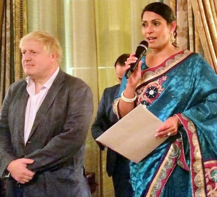 Priti Patel (right) and Boris Johnson at the Hinduja Diwali party in 2017.
