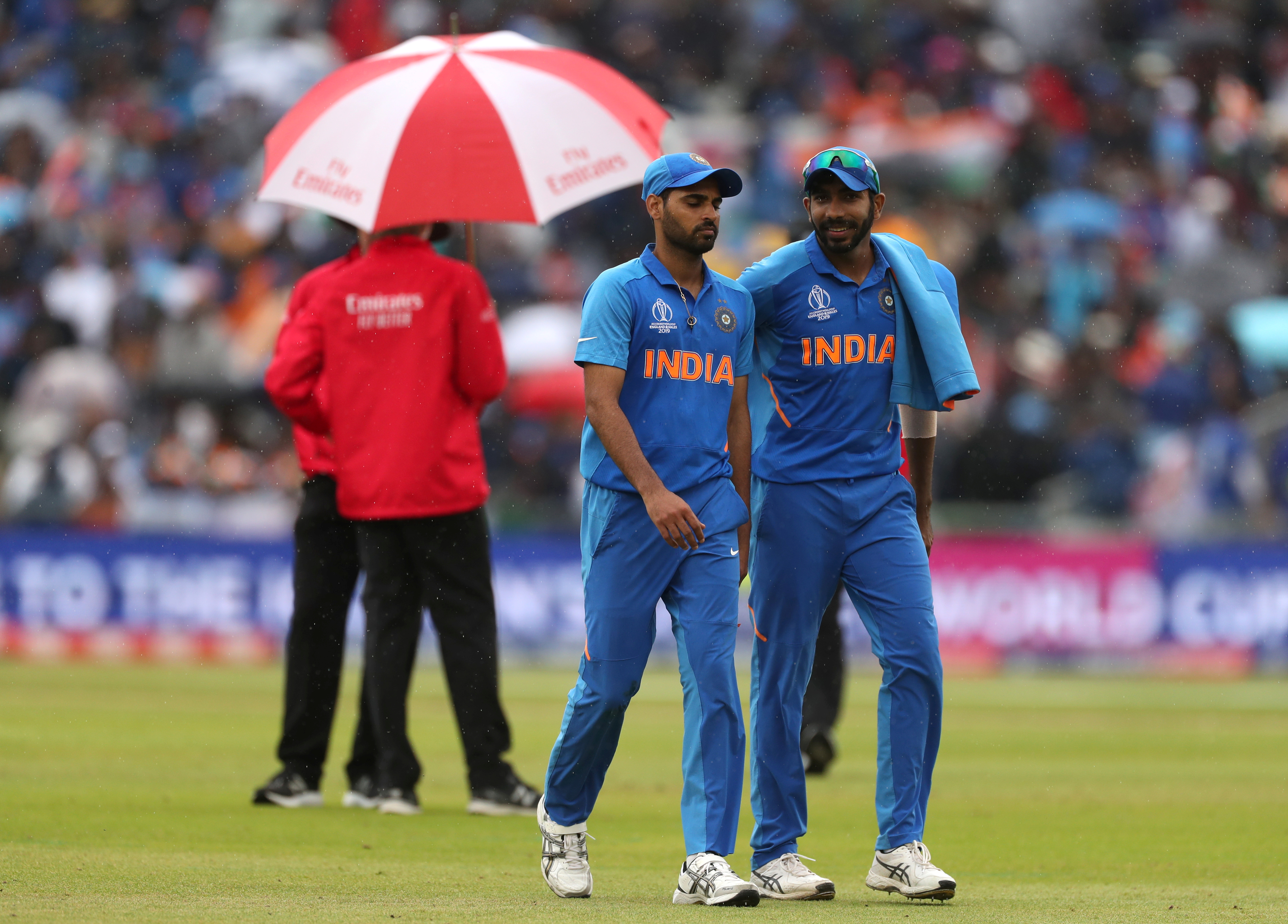 India's Bhuvneshwar Kumar and Jasprit Bumrah as play is stopped due to rain   Action Images via Reuters/Lee Smith