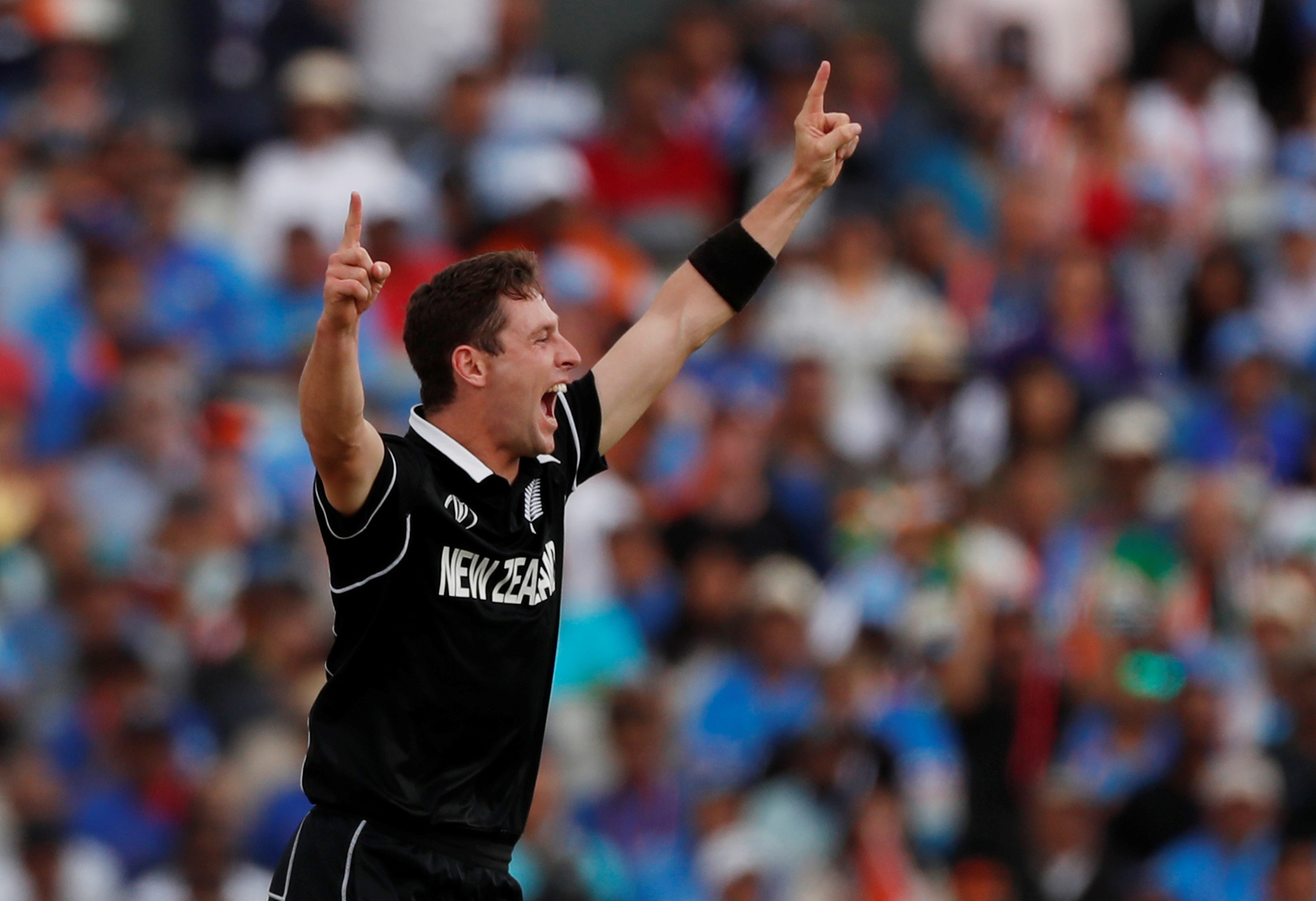 New Zealand's Matt Henry celebrates taking the wicket of India's Dinesh Karthik    Action Images via Reuters/Lee Smith