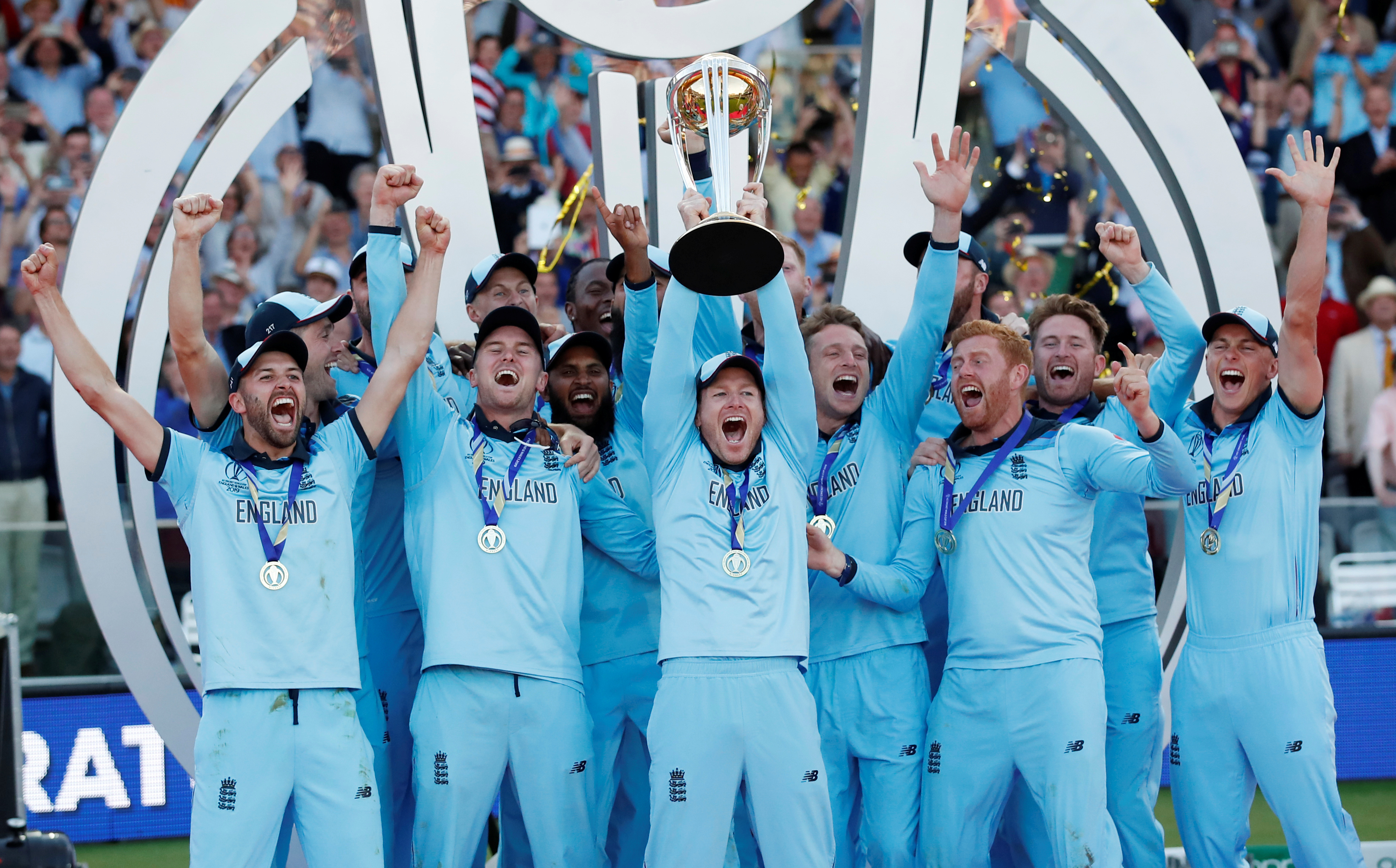 Cricket - ICC Cricket World Cup Final - New Zealand v England - Lord's, London, Britain - July 14, 2019   England's Eoin Morgan and team mates celebrate winning the world cup with the trophy       Action Images via Reuters/Andrew Boyers