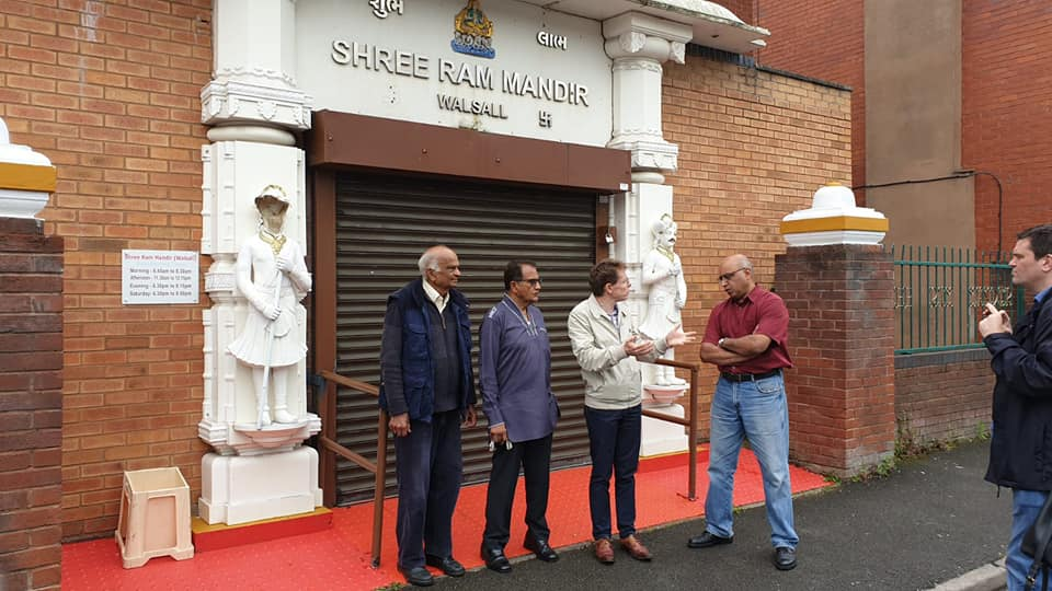Andy Street (second from right) speaks with members of the local community at the Shree Ram Mandir in Walsall, West Midlands after the temple was vandalized last week