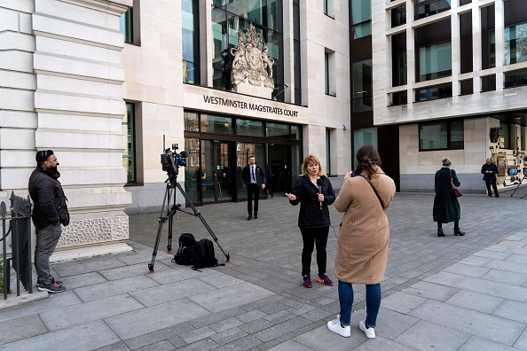 Members of the media work outside of Westminster Magistrates Court in London  (Photo: NIKLAS HALLE'N/AFP/Getty Images)