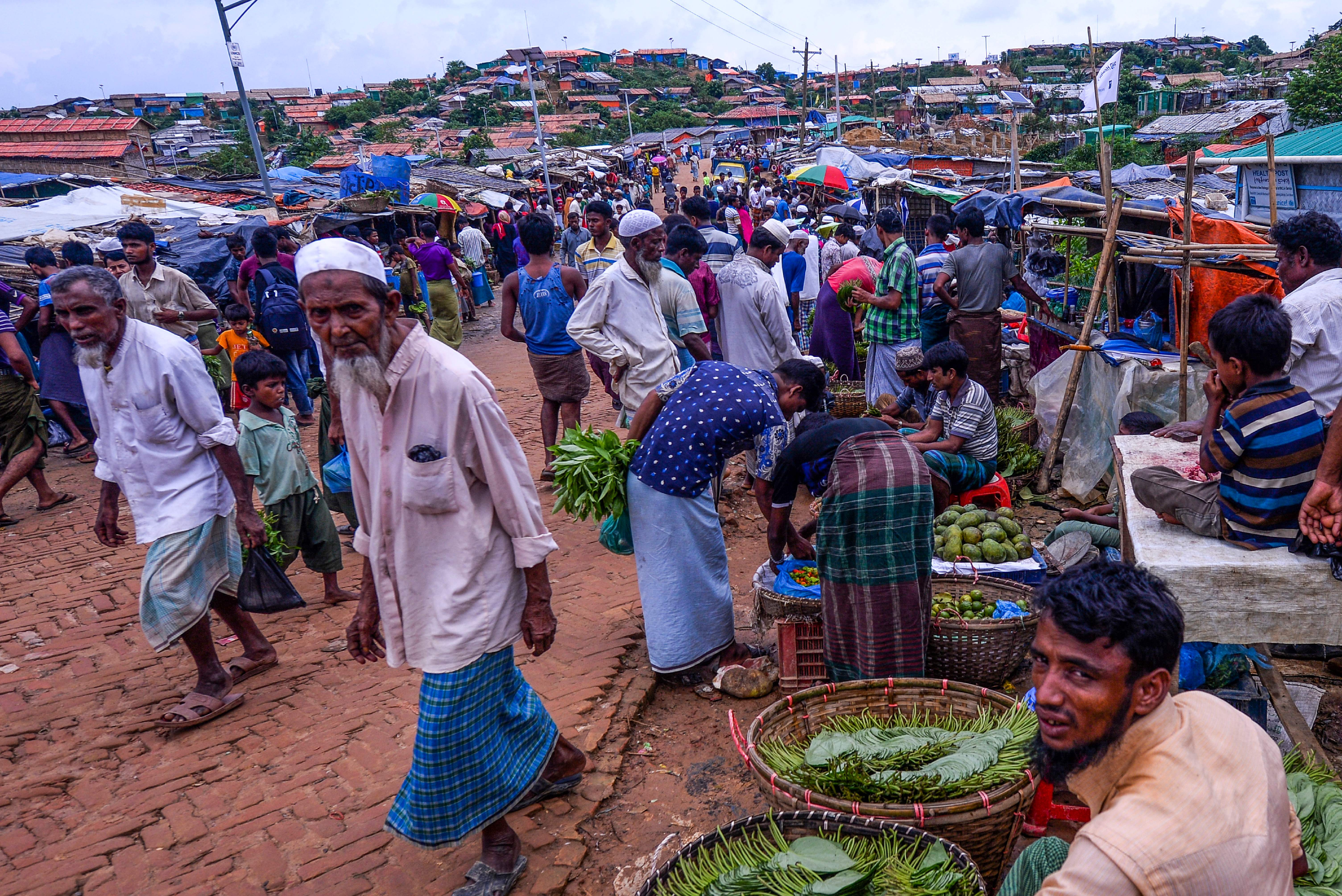 A Rohingya man sells betel leaves at a market at Kutupalong refugee camp in Ukhia on July 21, 2019. (Photo by MUNIR UZ ZAMAN / AFP)        (Photo credit should read MUNIR UZ ZAMAN/AFP/Getty Images)