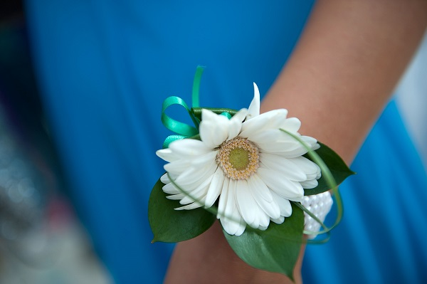 A student wears a corsage given to her by her date before the school prom.  (Photo by Bethany Clarke/Getty Images)