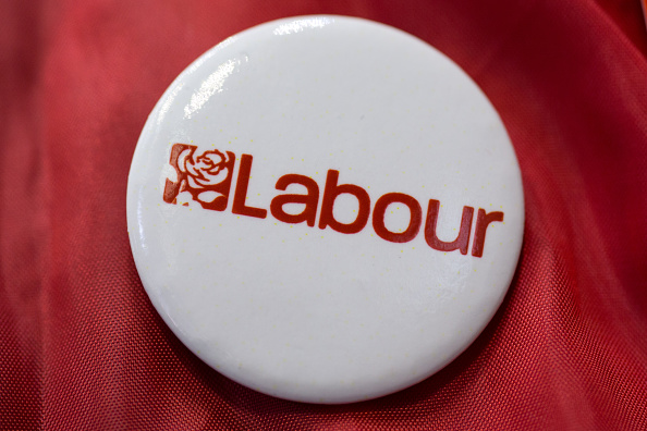 A close-up image of a pin badge bearing the logo for the Labour Party. (Photo by Oli Scarff/Getty Images)