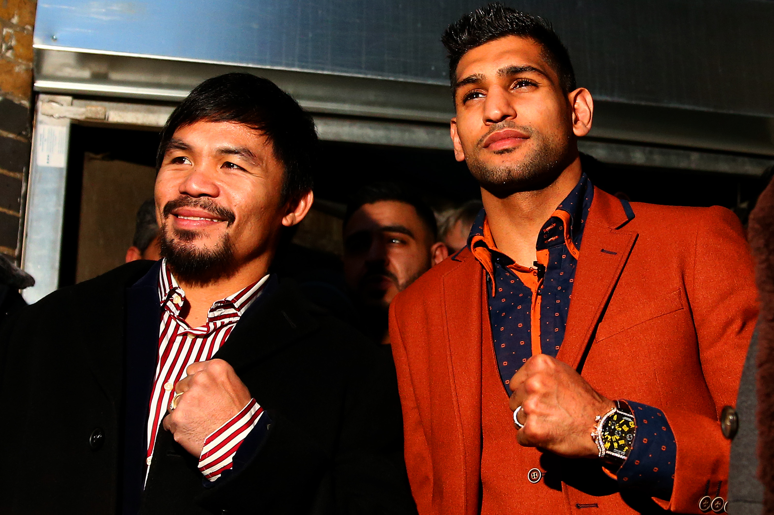 Manny Pacquiao and Amir Khan.  (Photo by Dan Istitene/Getty Images)