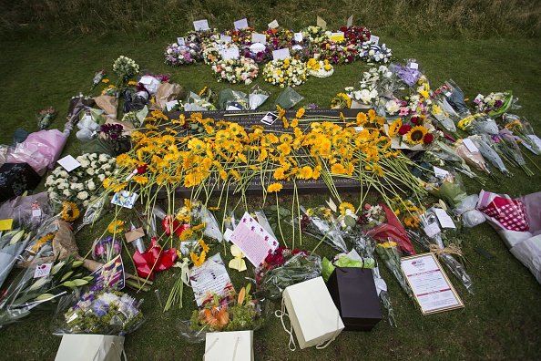 Flowers and tributes left by members of the public and survivors are placed by the 7/7 memorial in London's Hyde Park  (Photo: JACK TAYLOR/AFP/Getty Images)