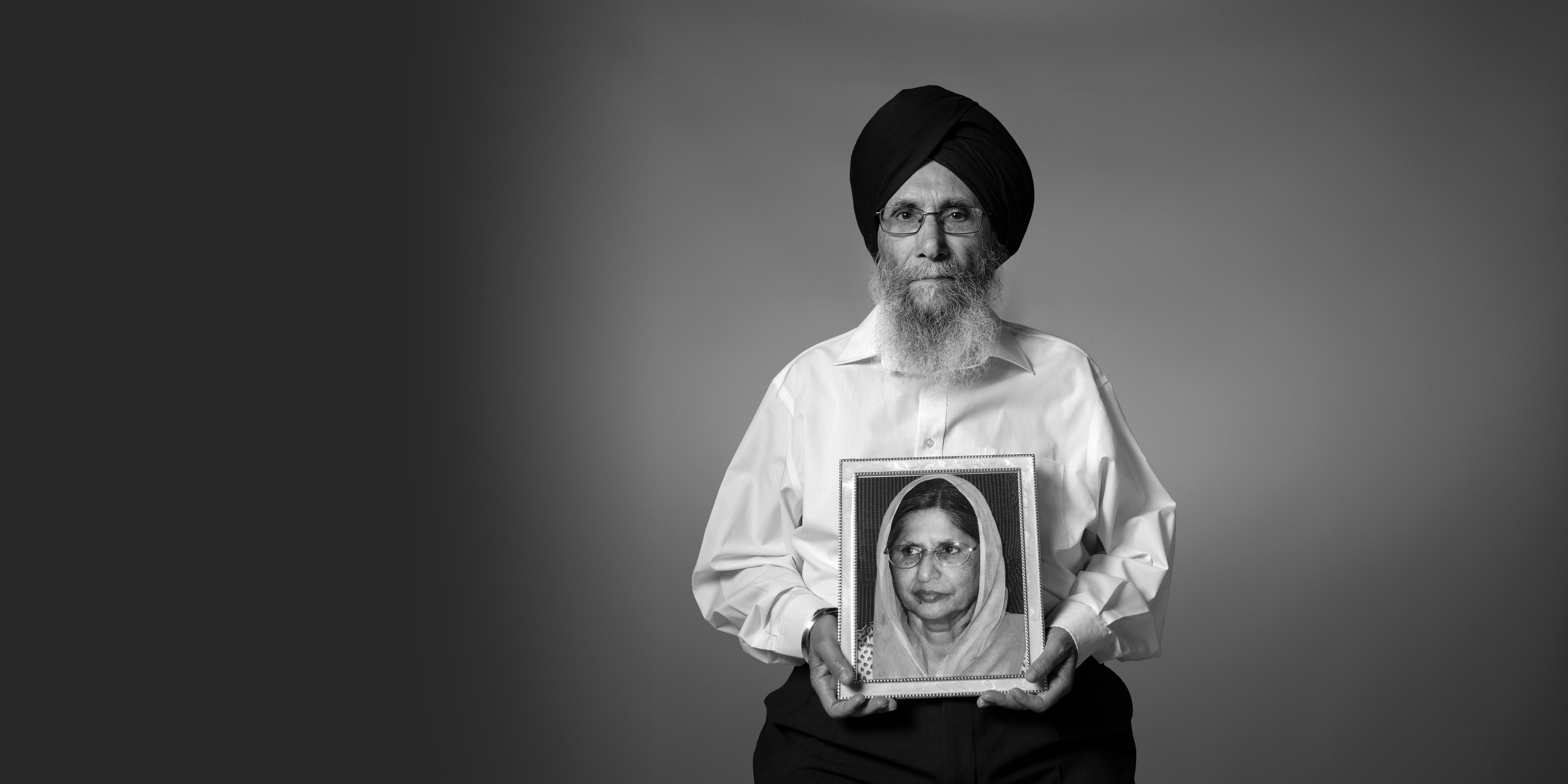 IN MEMORY OF: Malkit Singh Dhaliwal holds a picture of his wife Mohinder Kaur who died from myeloma