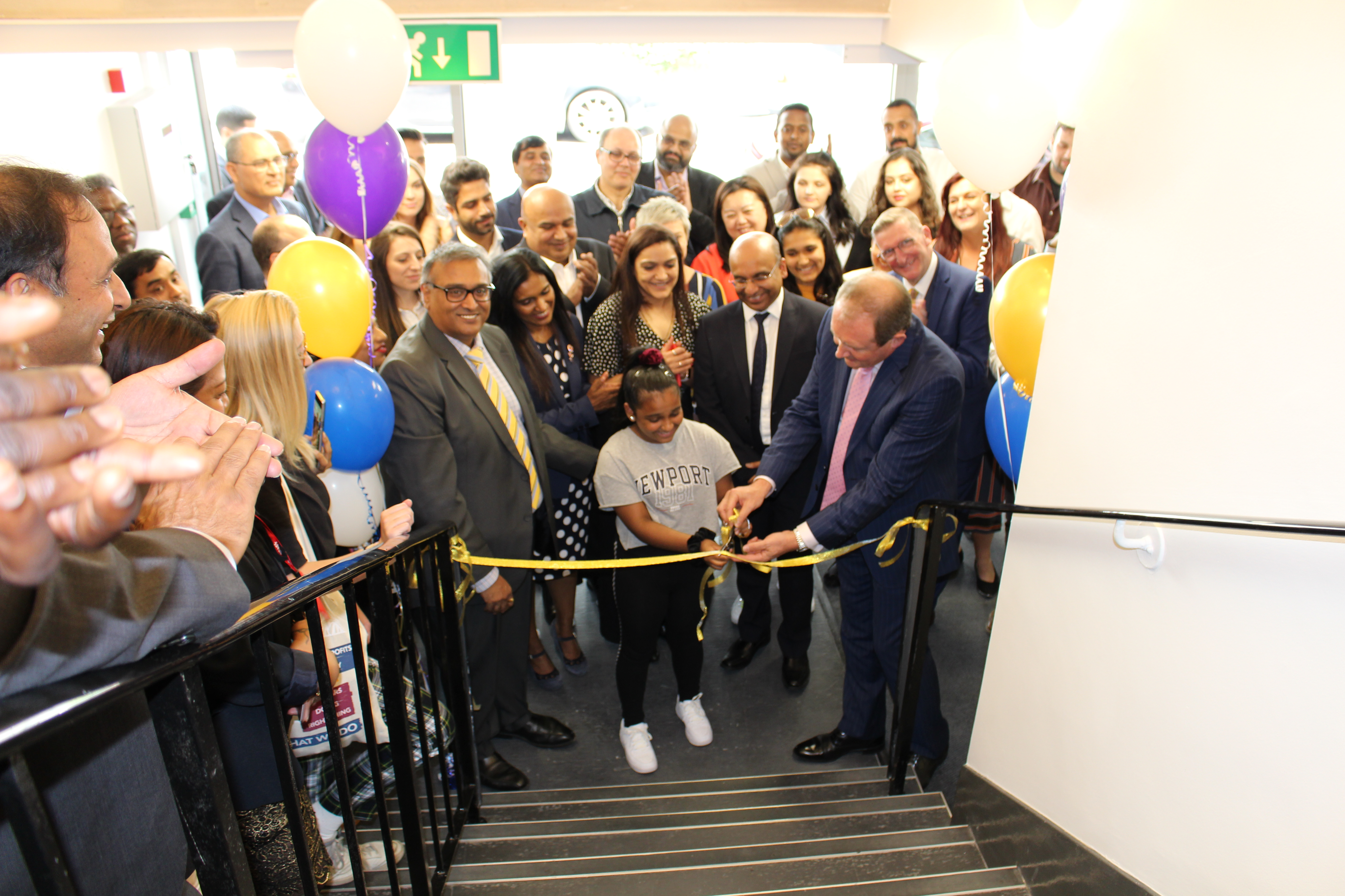 Guests celebrate at the Great Titchfield Street's  ribbon cutting ceremony last week