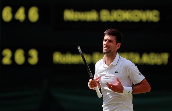 Tennis - Wimbledon - All England Lawn Tennis and Croquet Club, London, Britain - July 12, 2019 Serbia's Novak Djokovic celebrates after winning his semi-final match against Spain's Roberto Bautista Agut (REUTERS/Andrew Couldridge).