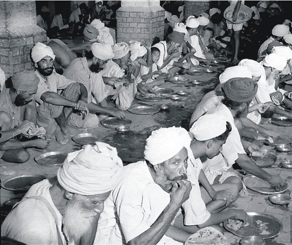This undated photo taken circa 1947/1948 shows Sikh people eating free food at a relief camp at Khalsa college in Amritsar following unrest in the wake of the Partition of India and Pakistan. In August 1947 the British Raj was dismantled, creating a newly independent India, with chunks of its western and eastern regions hurriedly amputated to create Pakistan. Partition etched a deep fissure in the region and threw millions of Hindus, Muslims and Sikhs on the road to their new homeland. Six thousand kilometres of new borders were drawn in just five weeks, fifteen million people were uprooted and possibly as many as two million lives were lost in the chaos and ensuing violence (Photo: STR/AFP/Getty Images).