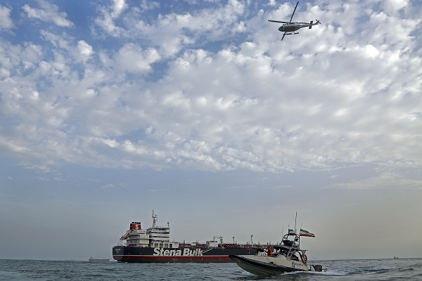 A picture taken on July 21, 2019, shows Iranian Revolutionary Guards patrolling around the British-flagged tanker Stena Impero as it's anchored off the Iranian port city of Bandar Abbas (Photo: HASAN SHIRVANI/AFP/Getty Images).