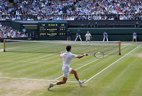 Tennis - Wimbledon - All England Lawn Tennis and Croquet Club, London, Britain - July 14, 2019 Serbia's Novak Djokovic in action during the final against Switzerland's Roger Federer (REUTERS/Toby Melville).