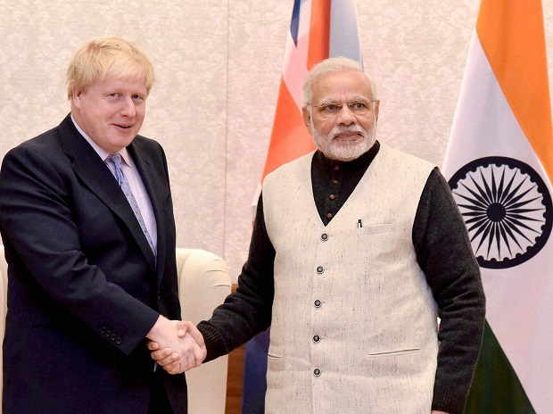 India prime minister Narendra Modi  (right) shakes hands with new British prime minister Boris Johnson  (PTI Photo)