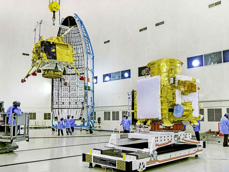 Officials carry out the hoisting of the Vikram Lander during the integration of Chandrayaan-2, at the launch center in Sriharikota.
