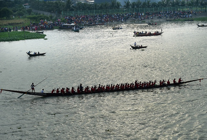 Bangladeshi men row during a traditional boat race on the Buriganga river in Dhaka.