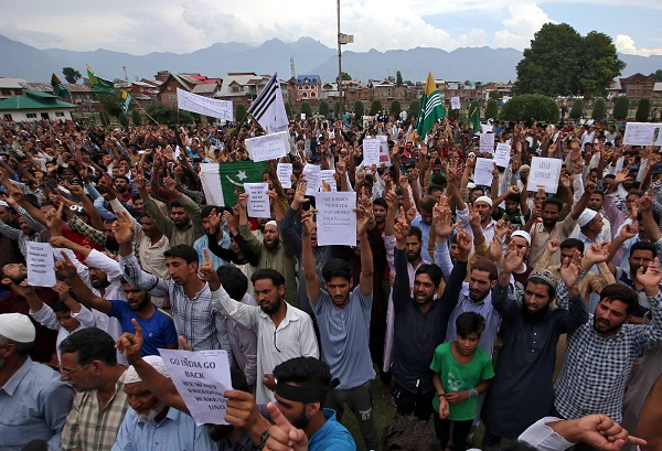 Kashmiris hold placards as they shout slogans at a protest after Friday prayers during restrictions after the Indian government scrapped the special constitutional status for Kashmir, in Srinagar August 16, 2019. (Photo: REUTERS/Danish Ismail)