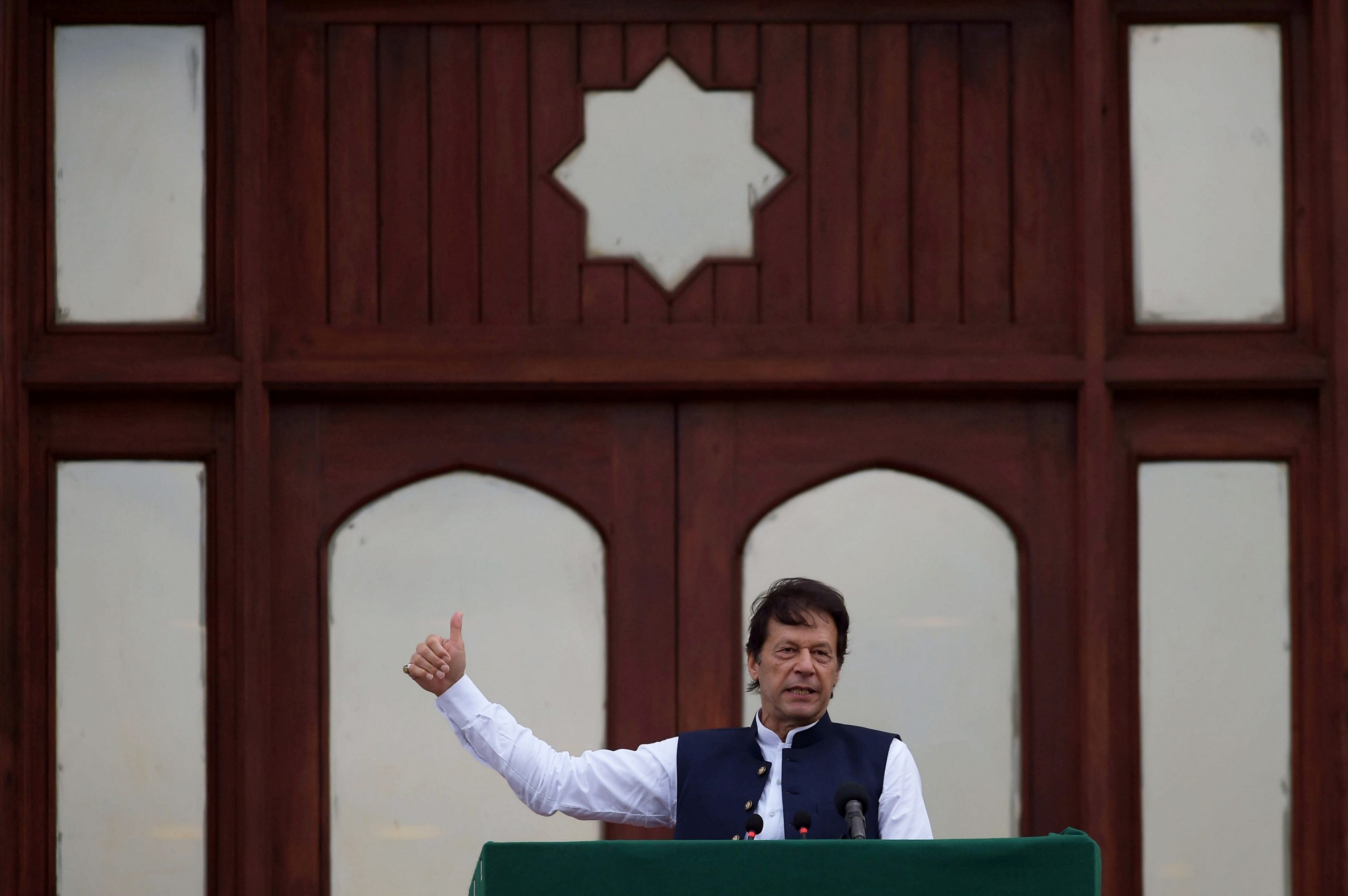 Pakistan's Prime Minister Imran Khan gestures as he speaks during a countrywide 'Kashmir Hour' demonstration to express solidarity with the people of Kashmir, at the Prime Minister's House in Islamabad, Pakistan, August 30, 2019. REUTERS/Stringer