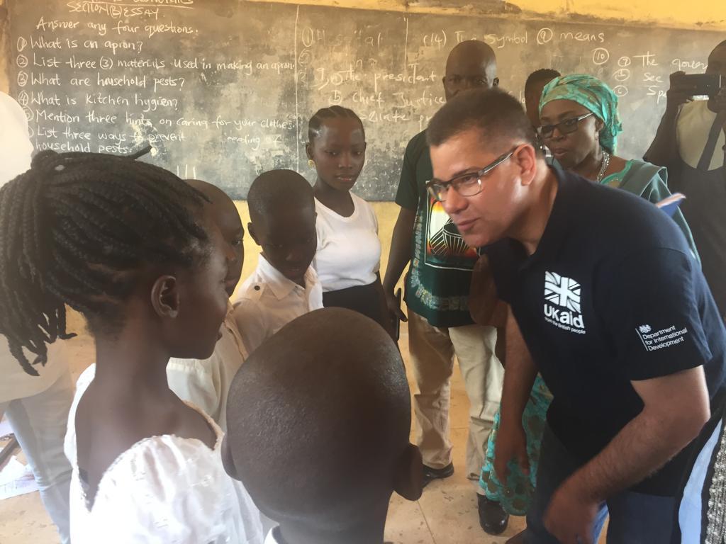 Alok Sharma visiting children in a school in Nigeria.
