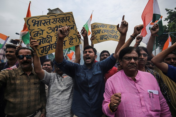 People shout slogans as they celebrate after the government scrapped the special status of Kashmir, in Ahmedabad, India, August 5, 2019 (REUTERS/Amit Dave).
