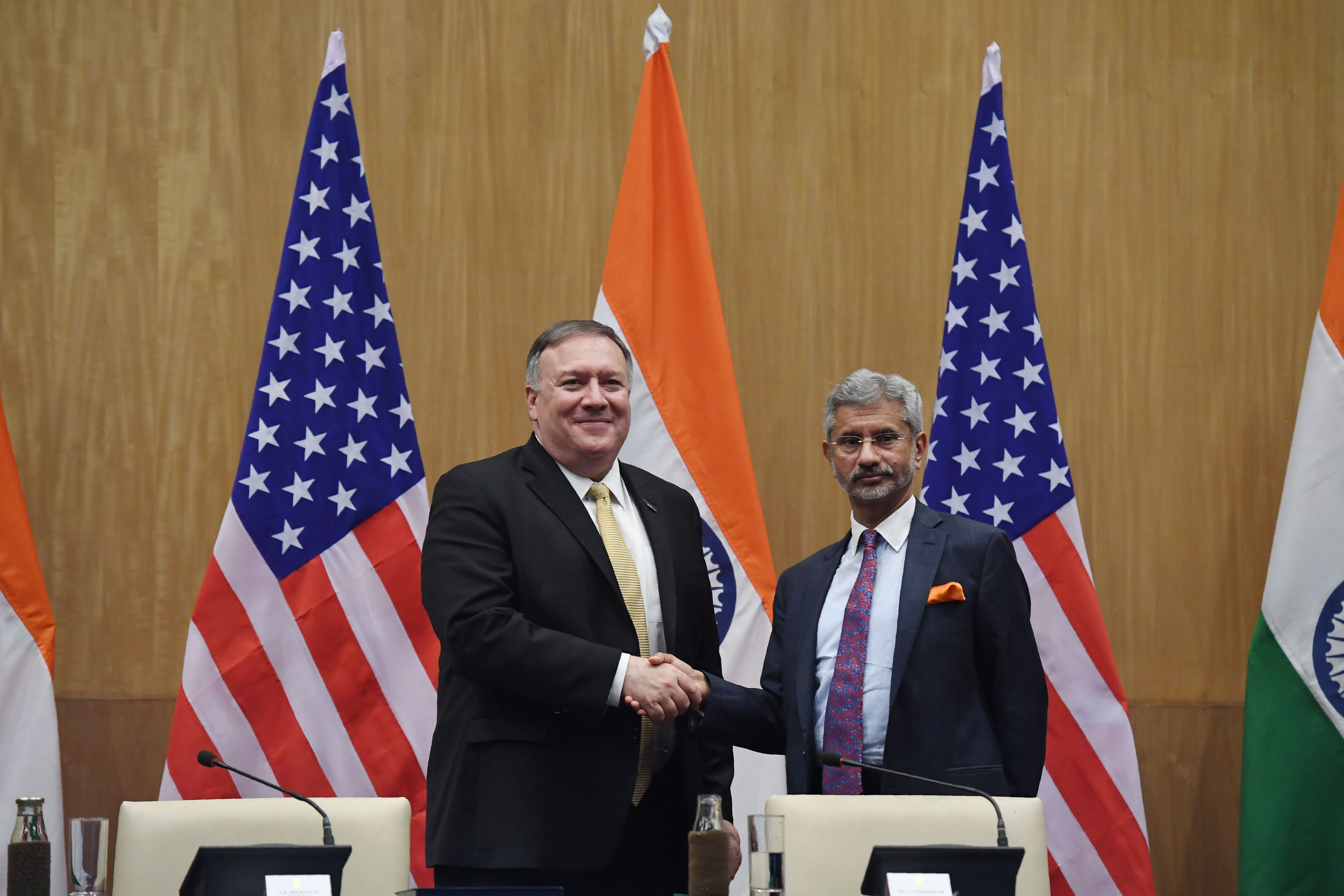 Indian Foreign Minister S. Jayashankar (R) and US Secretary of State Mike Pompeo shakes hands during a joint press statement in New Delhi. (Photo by PRAKASH SINGH / AFP)        (Photo credit should read PRAKASH SINGH/AFP/Getty Images)