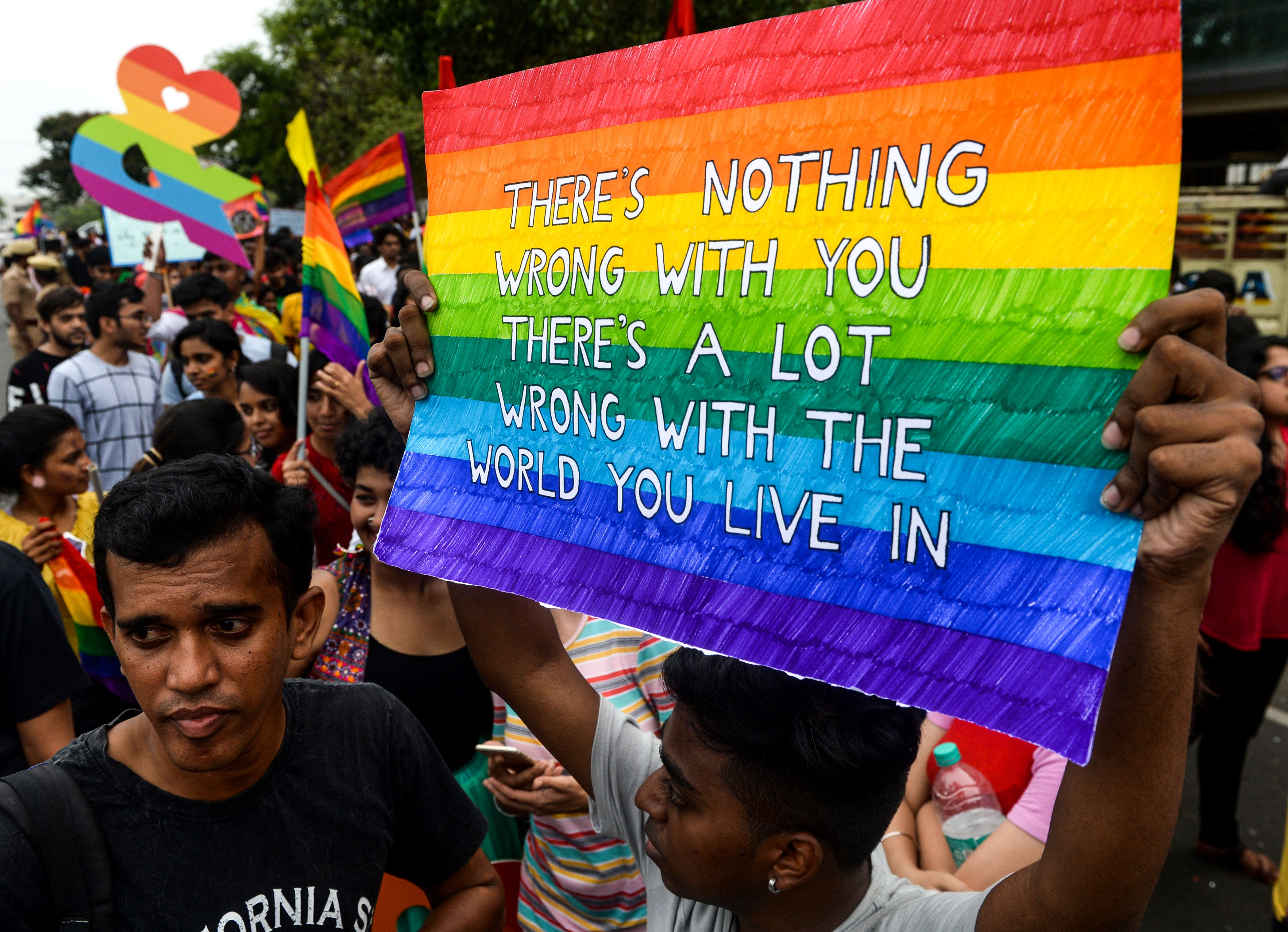 An Indian supporter of the lesbian, gay, bisexual, transgender (LGBT) community holds a placard as he takes part in a pride parade in Chennai on June 30, 2019. (Photo by ARUN SANKAR / AFP)        (Photo credit should read ARUN SANKAR/AFP/Getty Images)