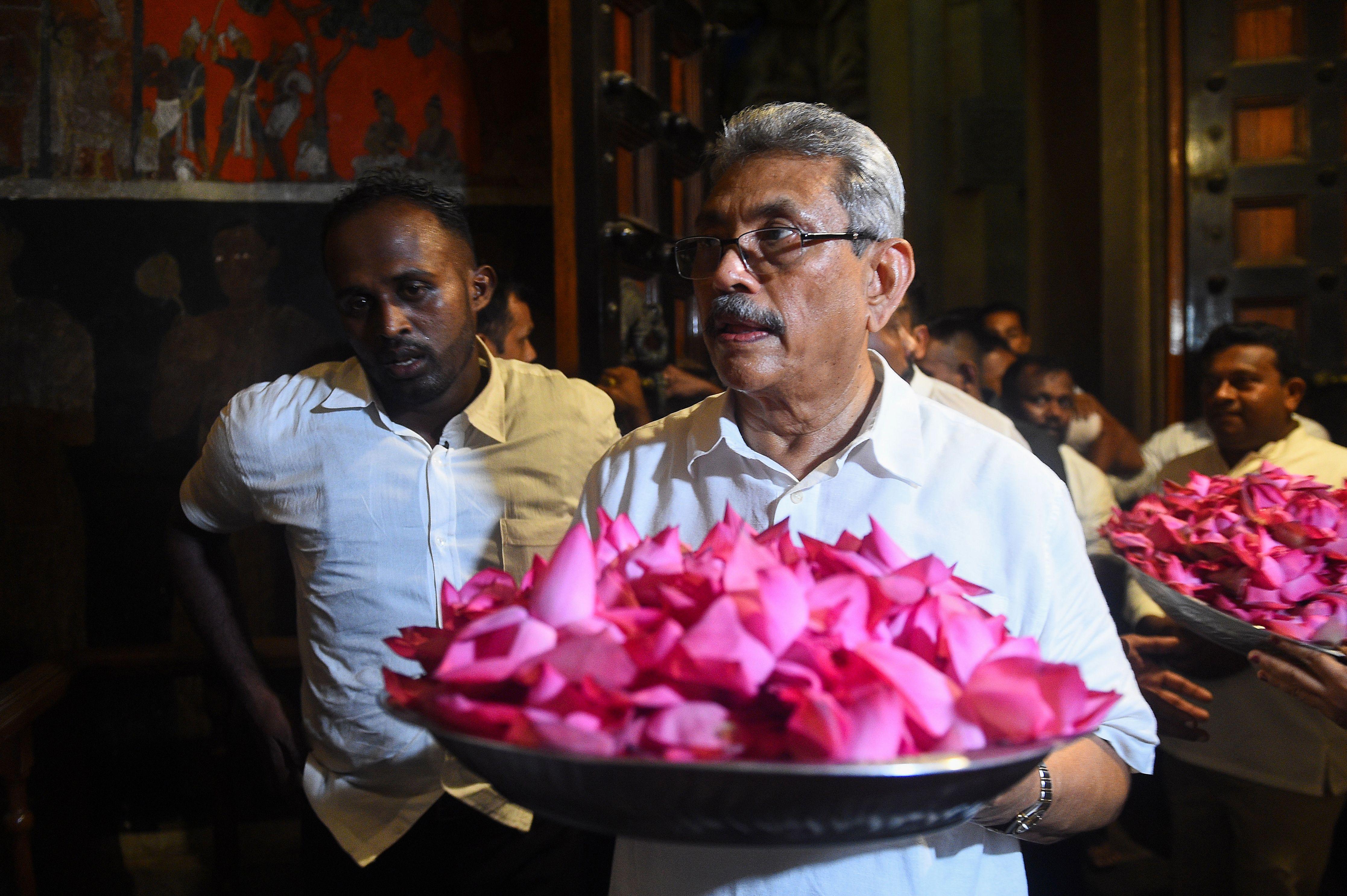 Gotabhaya Rajapakse (C), brother of Sri Lanka's opposition leader and former president, visits a Kelaniya Buddhist temple in Kelaniya  (ISHARA S. KODIKARA/AFP/Getty Images)