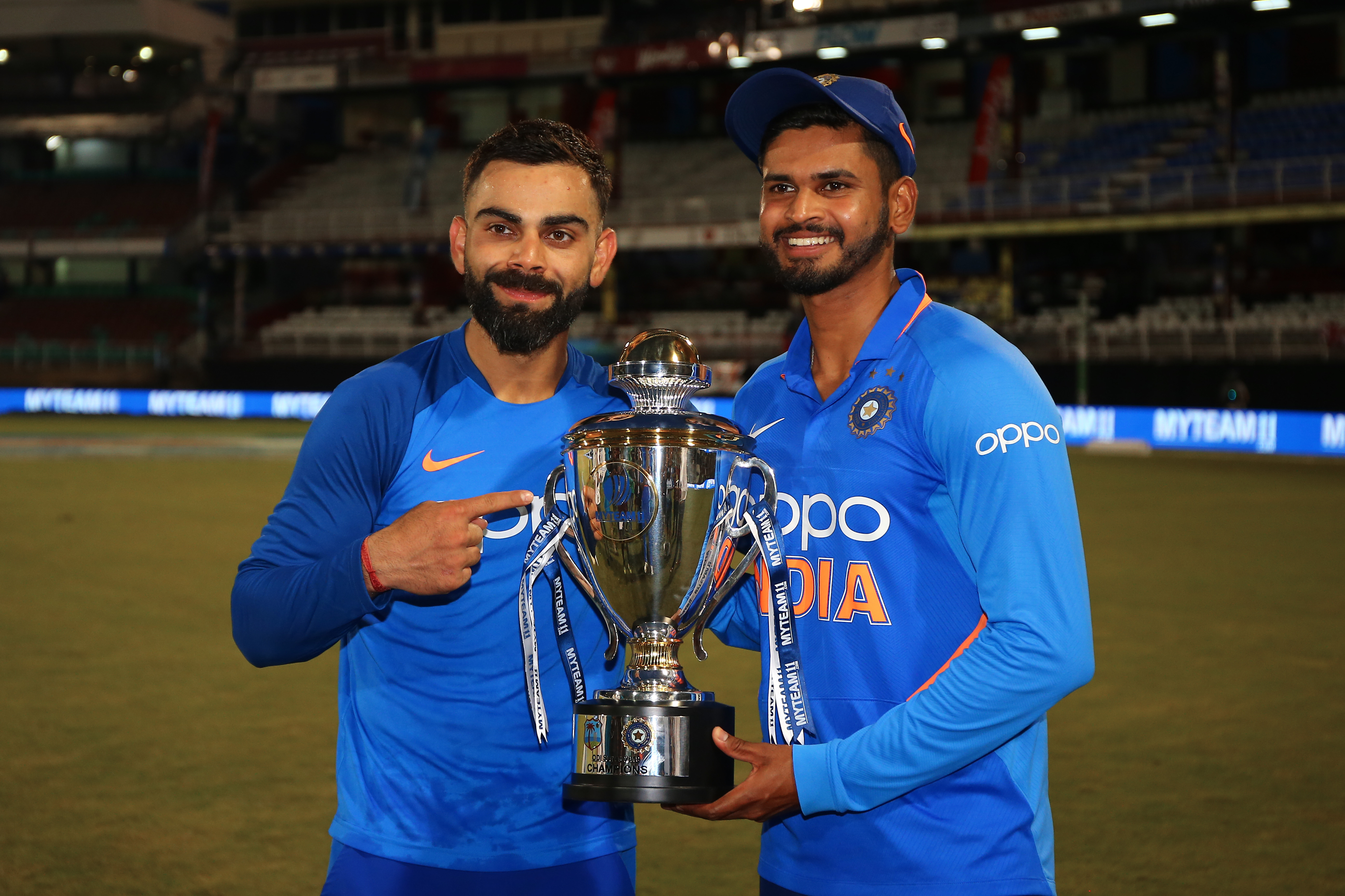 Virat Kohli (R) and Shreyas Iyer (R) of India with the winner's trophy during the third MyTeam11 ODI between the West Indies and India at the Queen's Park Oval  (Photo by Ashley Allen/Getty Images)