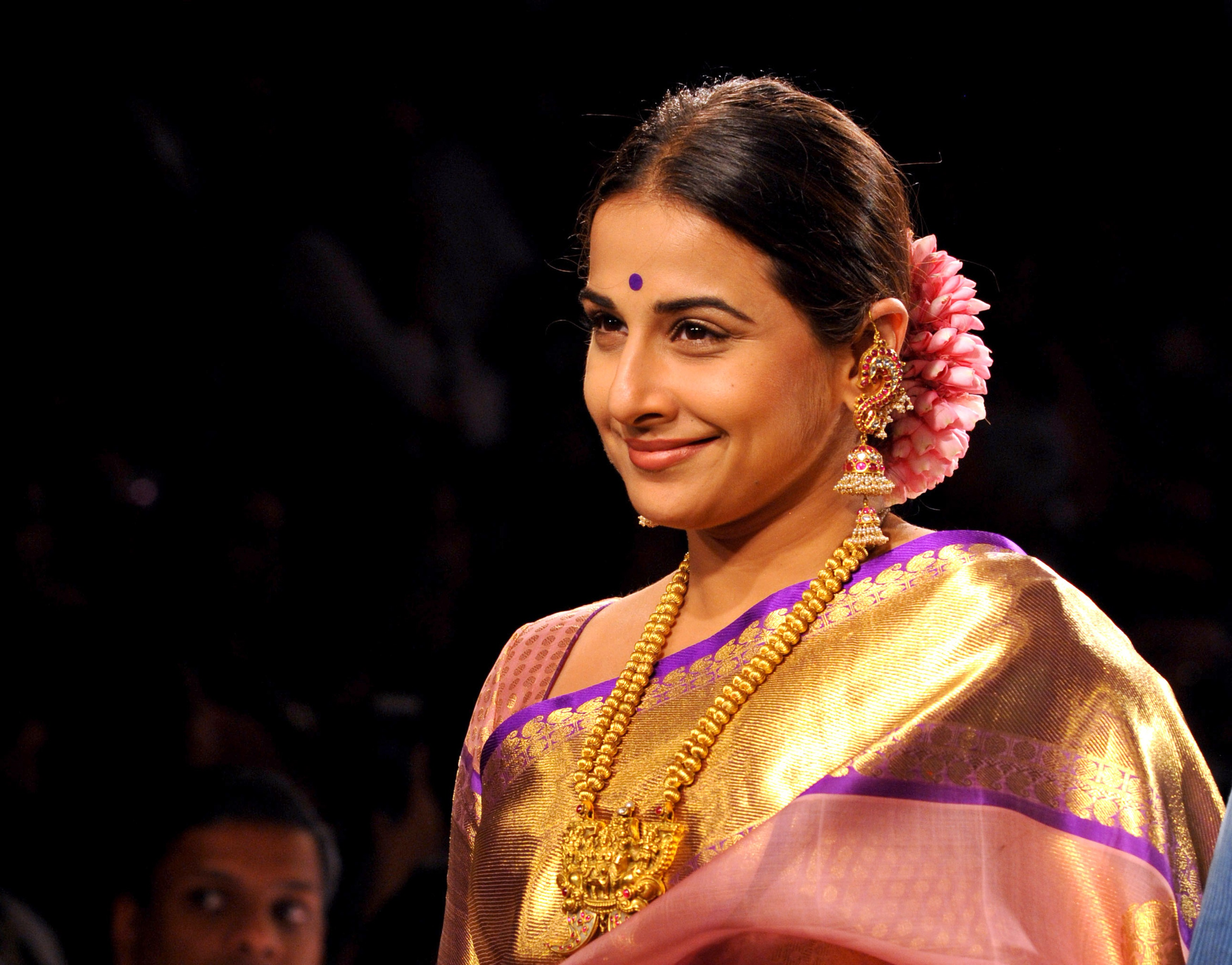 Indian Bollywood actress Vidya Balan showcases a creation by designer Gaurang on the second day of the Lakme Fashion Week (LFW) summer/resort 2015 in Mumbai on March 19, 2015.  AFP PHOTO        (Photo credit should read STR/AFP/Getty Images)