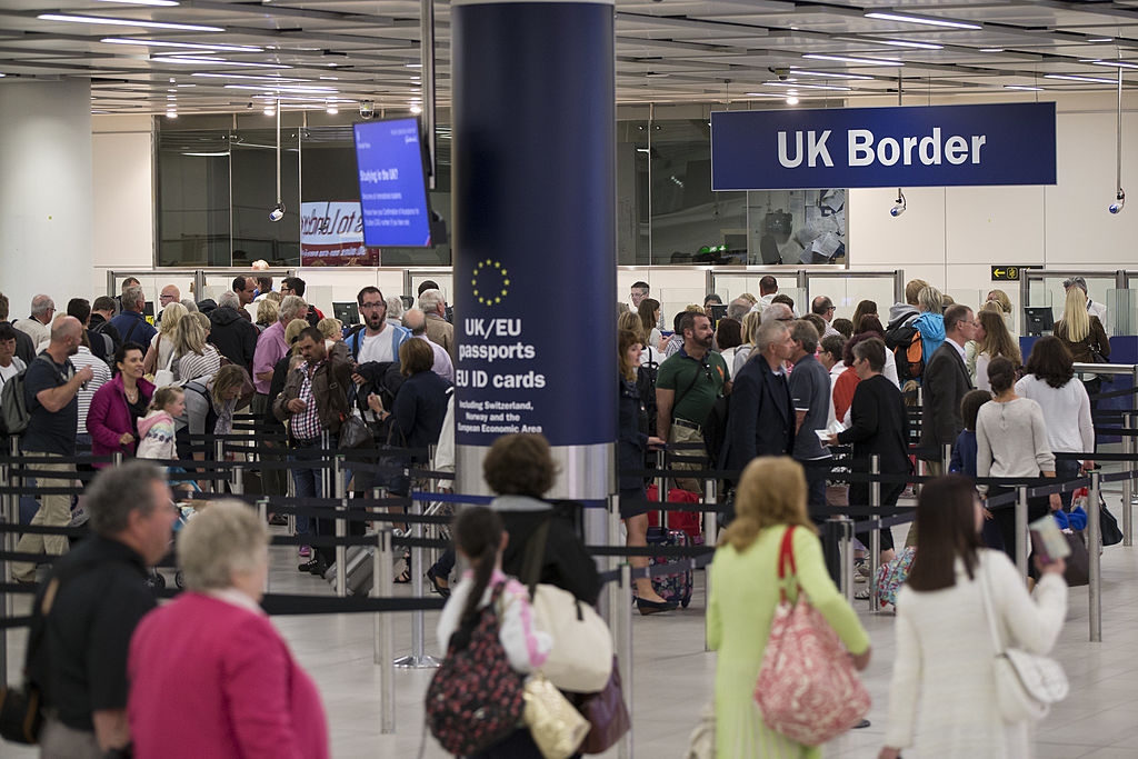 Border Force check the passports of passengers arriving at Gatwick Airport.  (Photo by Oli Scarff/Getty Images)