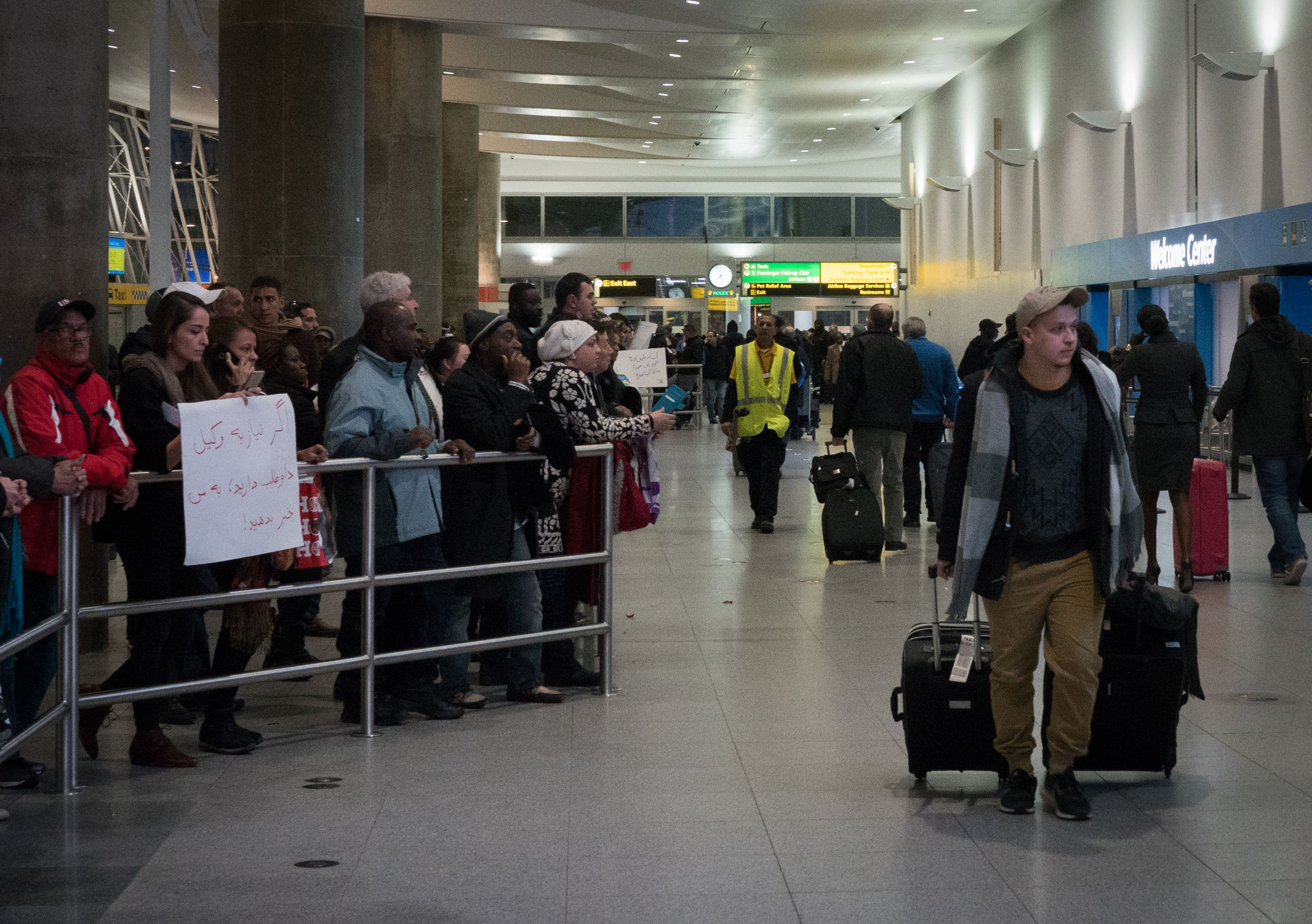 A volunteer holds up a sign asking if anyone needs a lawyer at JFK International Airport's Terminal 4 are on hand to work with people that may have been detained from the seven countries under President Donald Trump's Executive Order, February 4, 2017 in New York. / AFP / Bryan R. Smith        (Photo credit should read BRYAN R. SMITH/AFP/Getty Images)