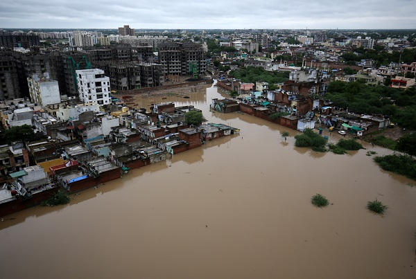An aerial view shows a flooded residential area after heavy rains in Ahmedabad, India, August 10, 2019 (REUTERS/Amit Dave).
