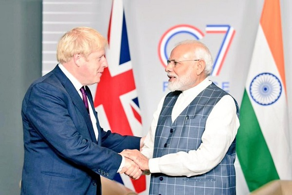 The leaders on Sunday (25) agreed to further strengthen the bilateral partnership between the two countries after Brexit — including by working more closely together to overcome barriers to trade and build on economic ties, a statement from the British prime minister's office said (Photo: @MEAIndia/Twitter).