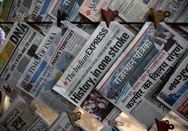 Newspapers, with headlines about prime minister Narendra Modi's decision to revoke special status for the disputed Kashmir region, are displayed for sale at a pavement in Ahmedabad, India, August 6, 2019 (Photo: REUTERS/Amit Dave).